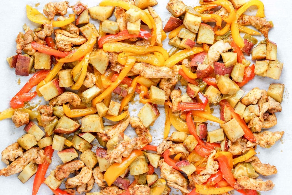 Fajita Sheet Pan with Chicken, Peppers and Sweet Potatoes. https://www.atwistedplate.com/fajita-sweet-potato-sheet-pan-dinner/