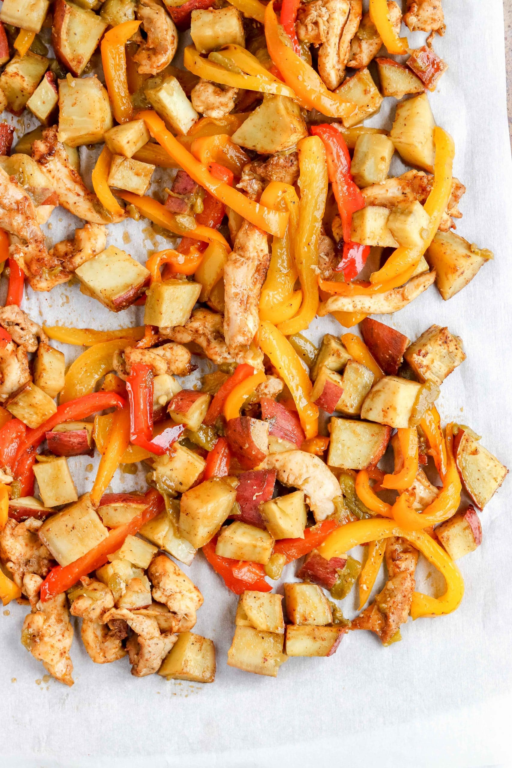 Fajita Sheet Pan with Chicken, Peppers and Sweet Potatoes. https://www.atwistedplate.com/fajita-sweet-potato-sheet-pan-dinner/